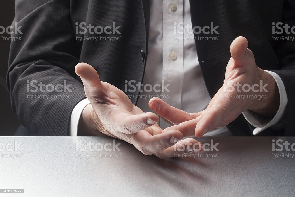business explanation by hands stock photo