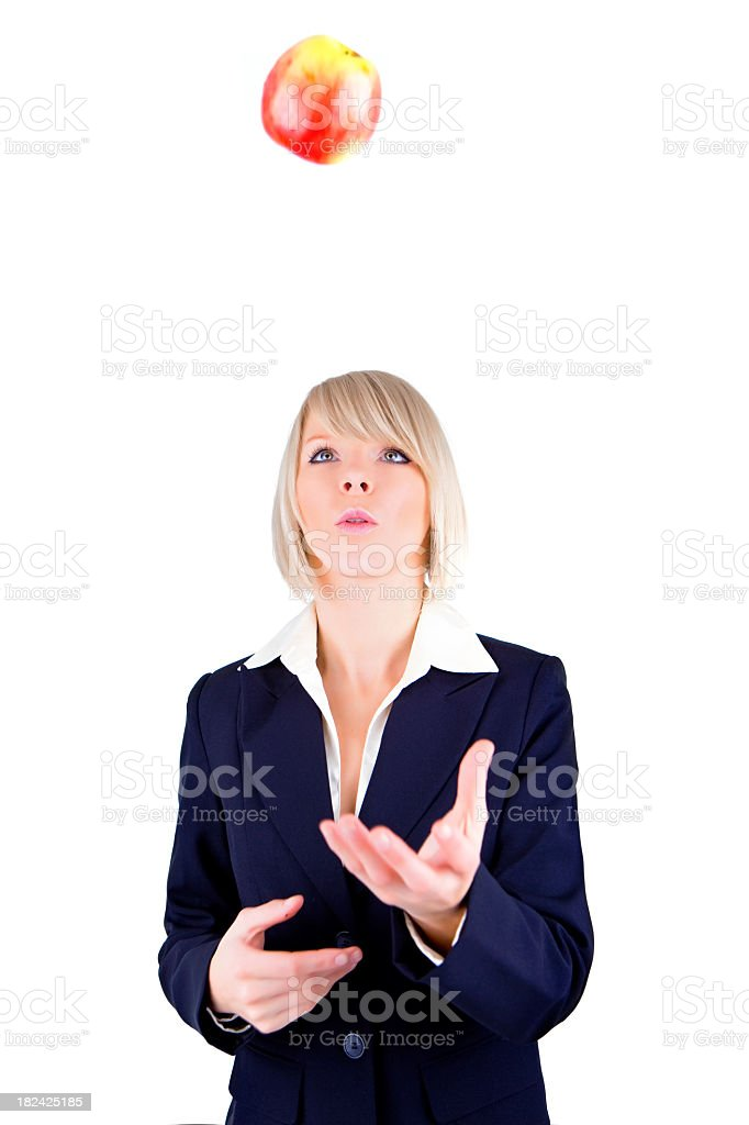 Business female throwing apple royalty-free stock photo