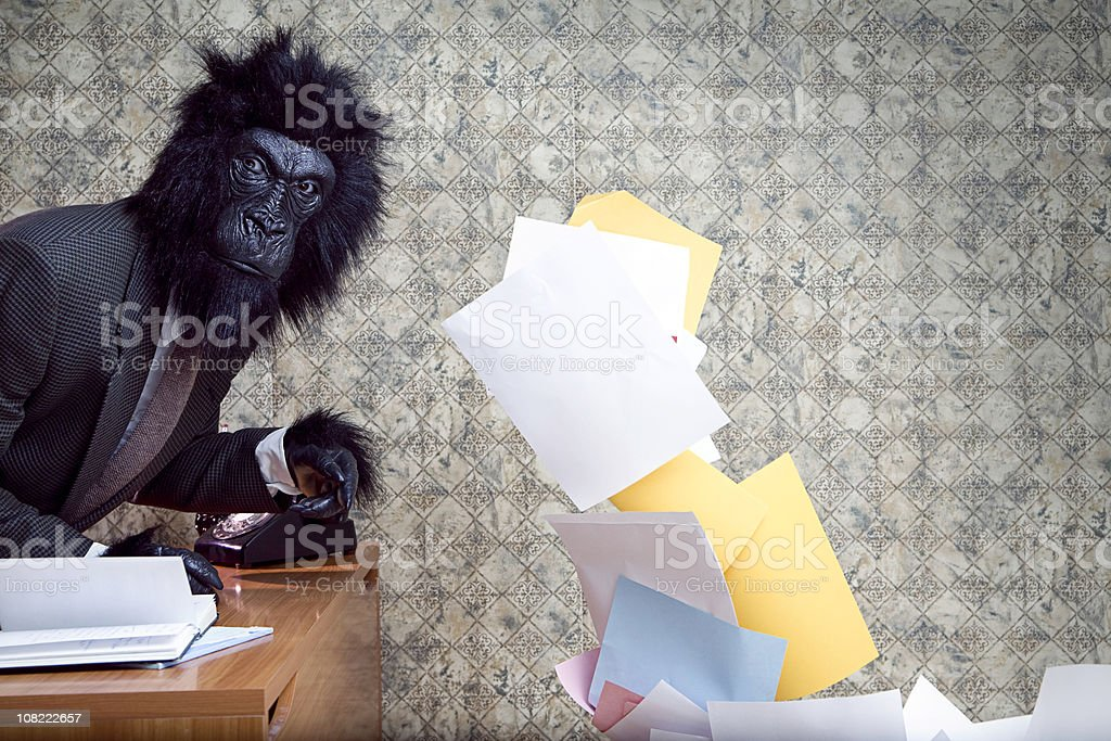Business Gorilla in the Office Throwing Paper royalty-free stock photo