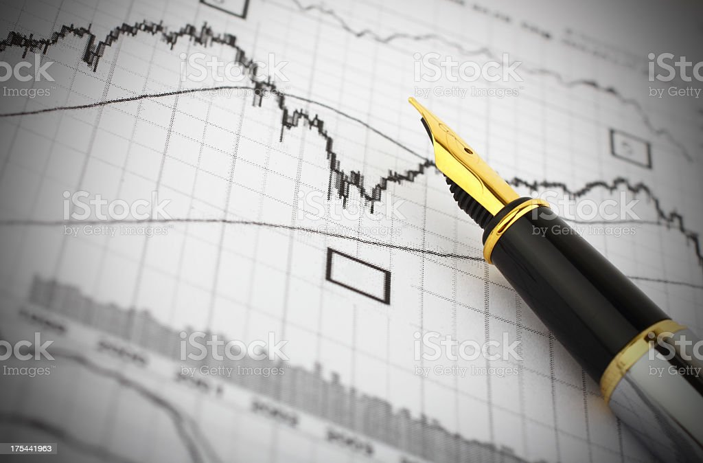 Business graph and fountain pen stock photo