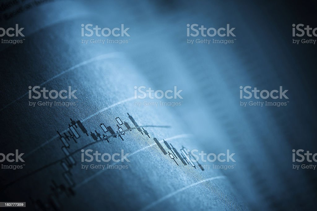 Business graph in newspaper royalty-free stock photo