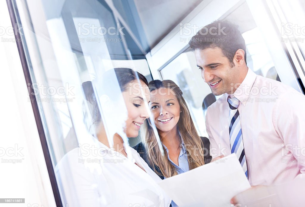 Business group at a building entrance royalty-free stock photo
