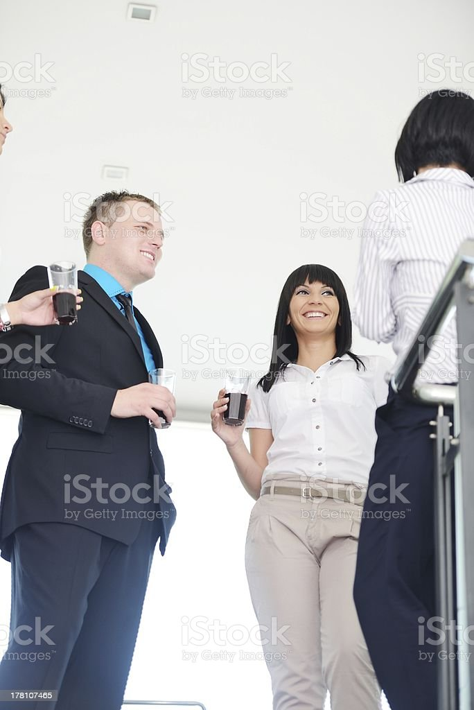 Business group celebrating a victory holding glasses with drink royalty-free stock photo