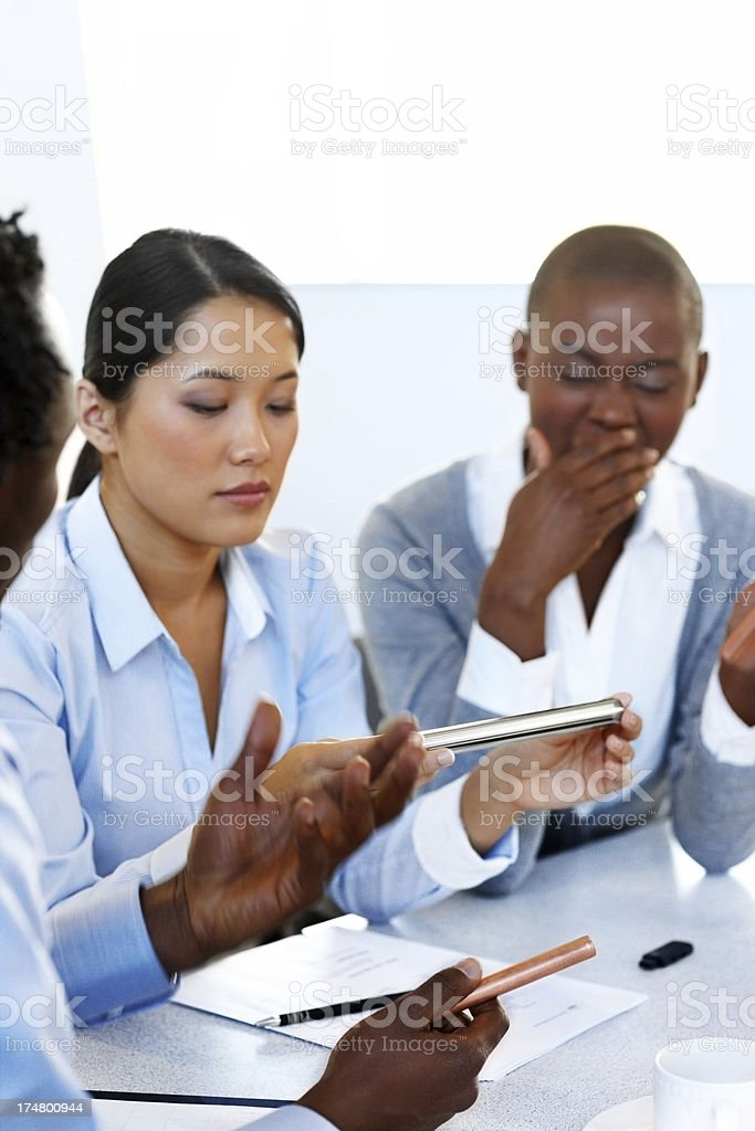 Business group discussing product quality royalty-free stock photo