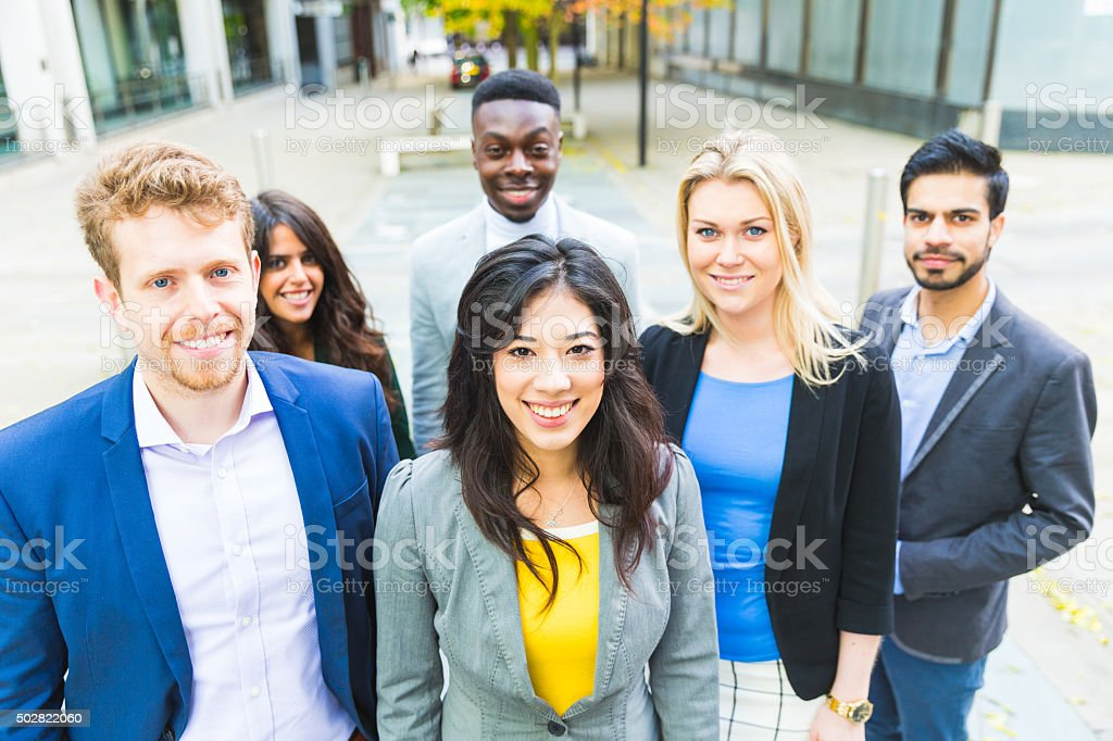 Business group looking at camera stock photo