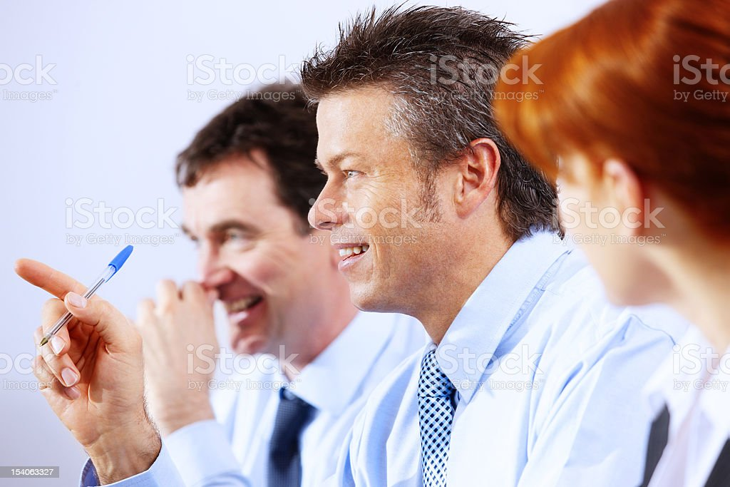 Business group sitting in a row laughing royalty-free stock photo