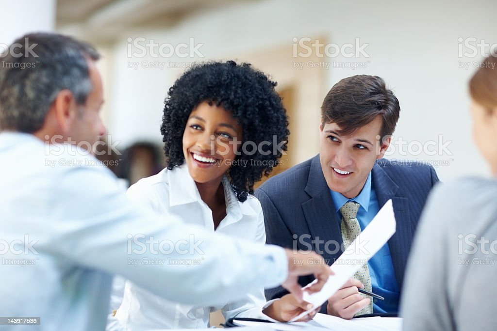 Business group smiling during office meeting royalty-free stock photo