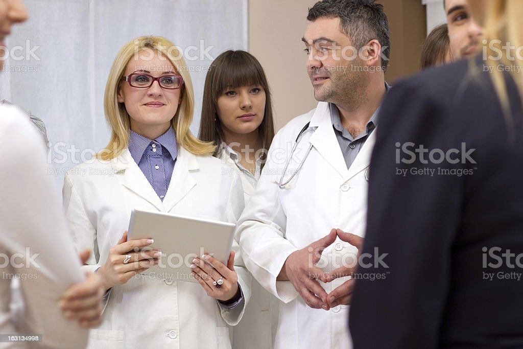 Business group talking to a doctor royalty-free stock photo