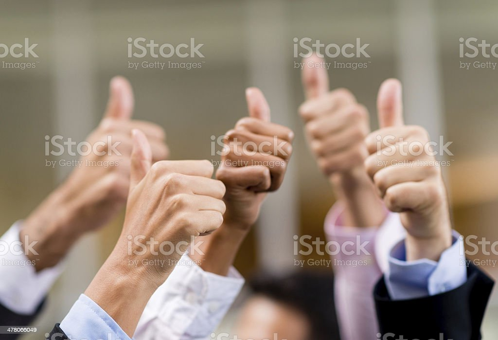 Business group with thumbs up stock photo