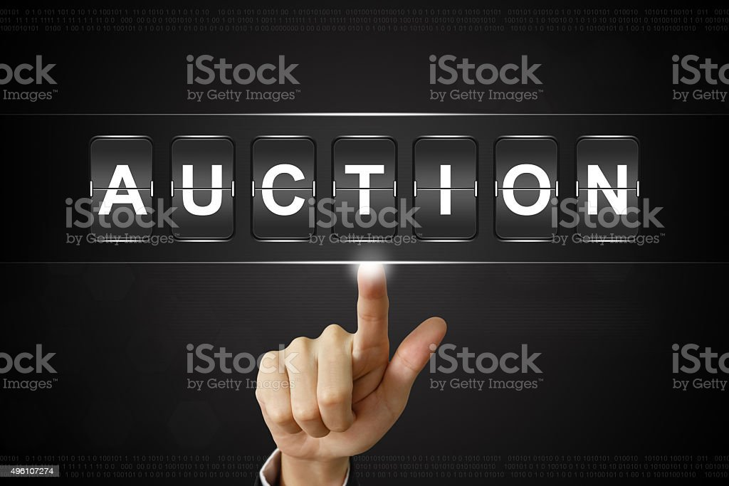 business hand clicking auction on Flipboard stock photo