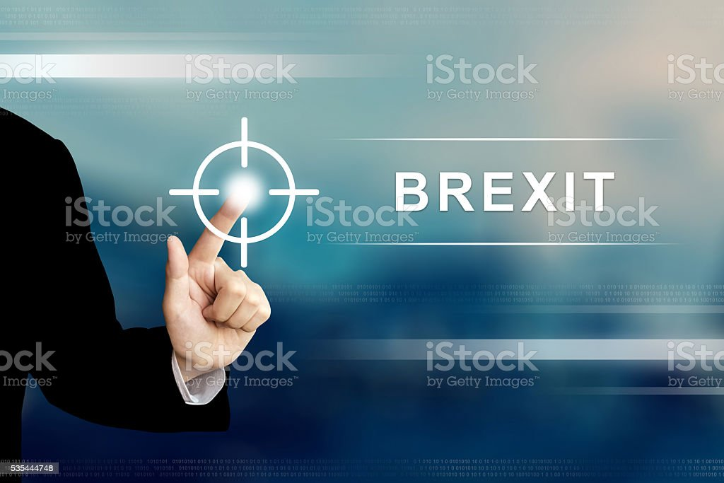 business hand clicking brexit or british exit button stock photo