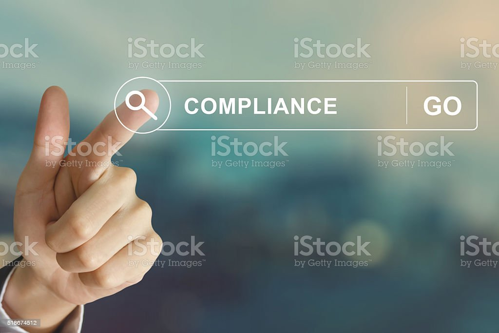 business hand clicking compliance button on search toolbar stock photo