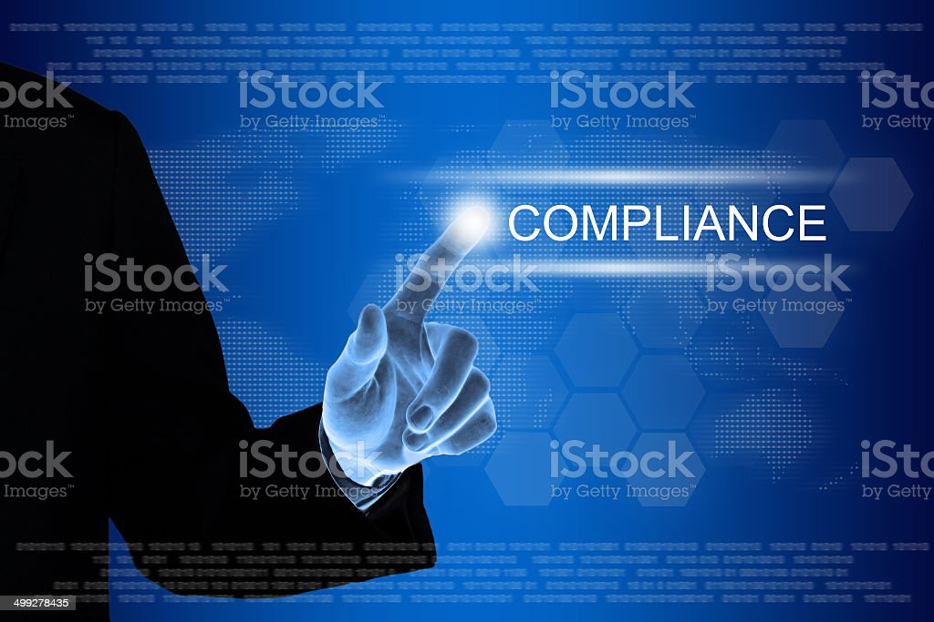 business hand clicking compliance button on touch screen stock photo