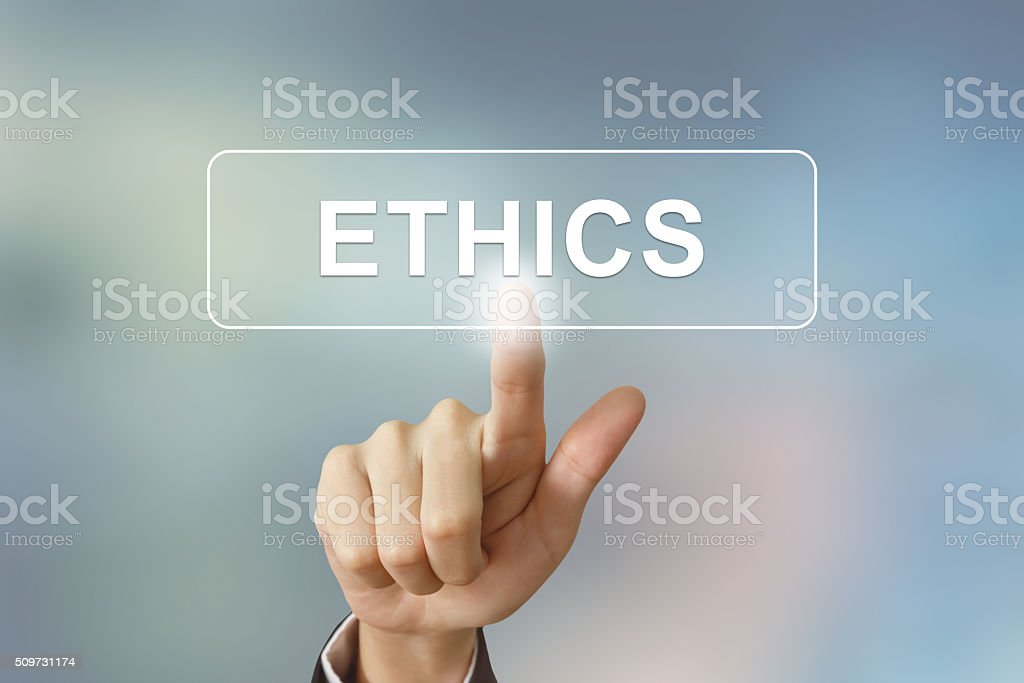 business hand clicking ethics button on blurred background stock photo