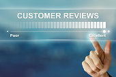 business hand clicking excellent customer reviews