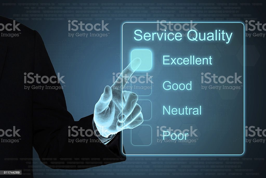 business hand clicking service quality on touch screen stock photo