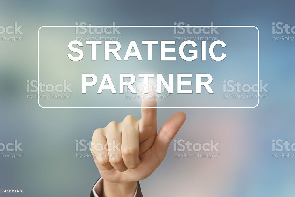 business hand clicking strategic partner button stock photo
