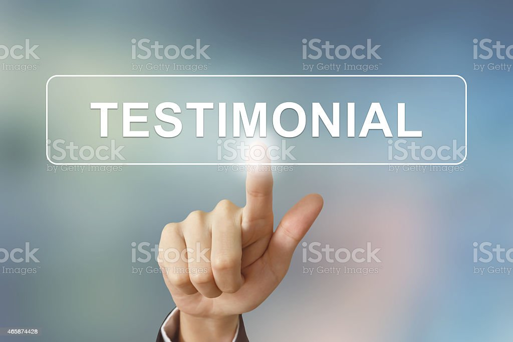 business hand clicking testimonial button on blurred background stock photo