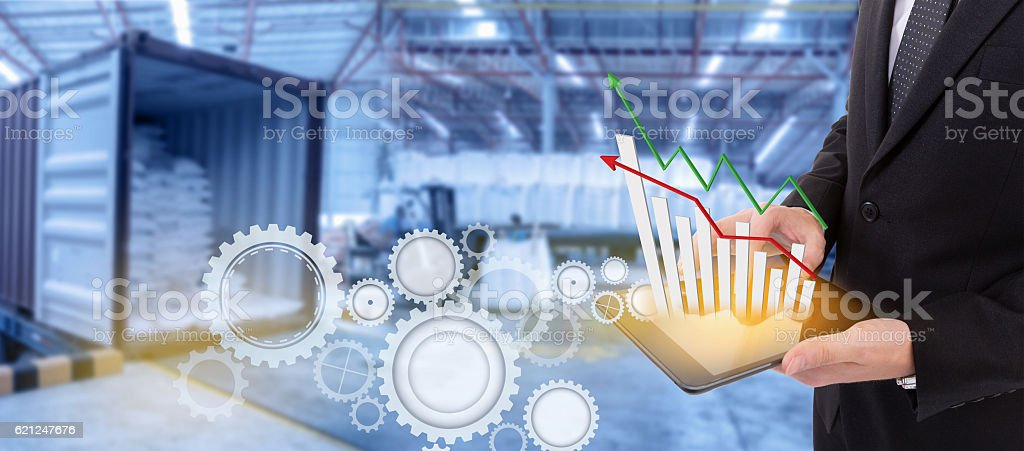 Business hand holding growth chart of transport business on tablet. stock photo
