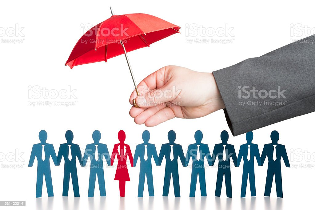 Business hand holding red protective umbrella over paper chain people stock photo