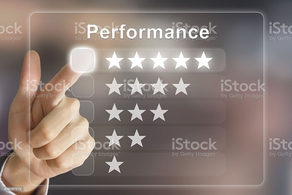 business hand pushing performance on virtual screen stock photo