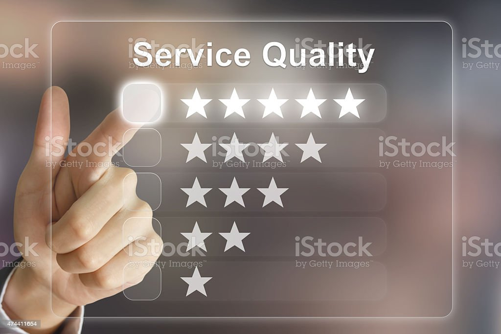 business hand pushing service quality on virtual screen stock photo
