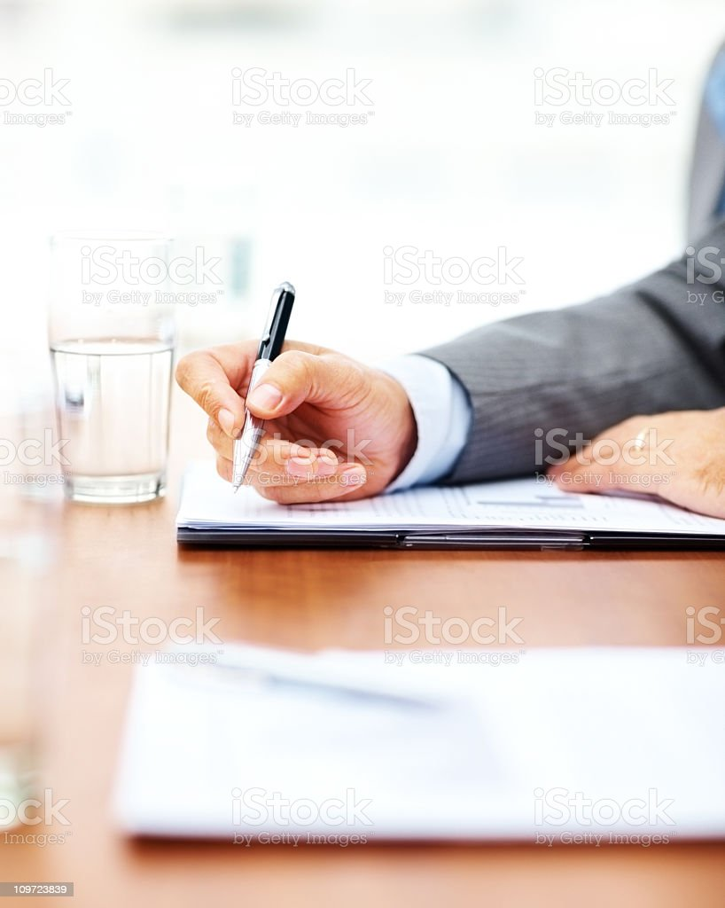 Business hand signing a document royalty-free stock photo
