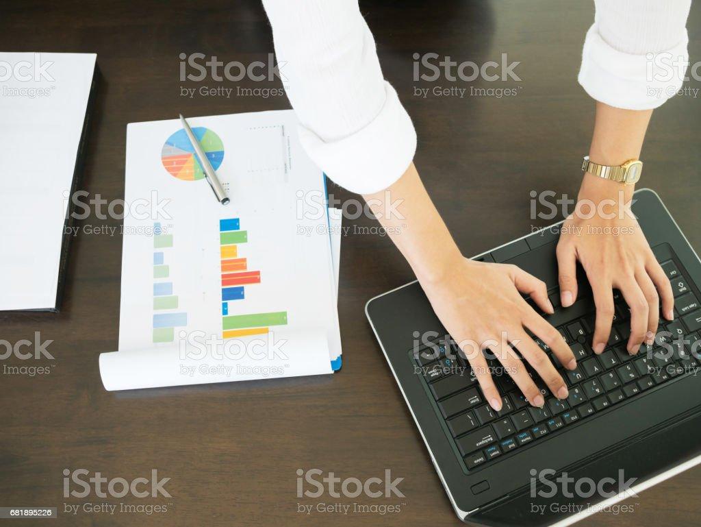 business hand typing laptop keyboard stock photo
