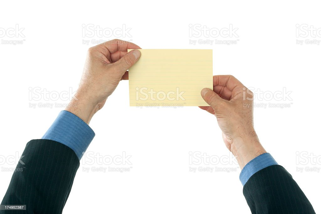 Business hands holding yellow index card royalty-free stock photo
