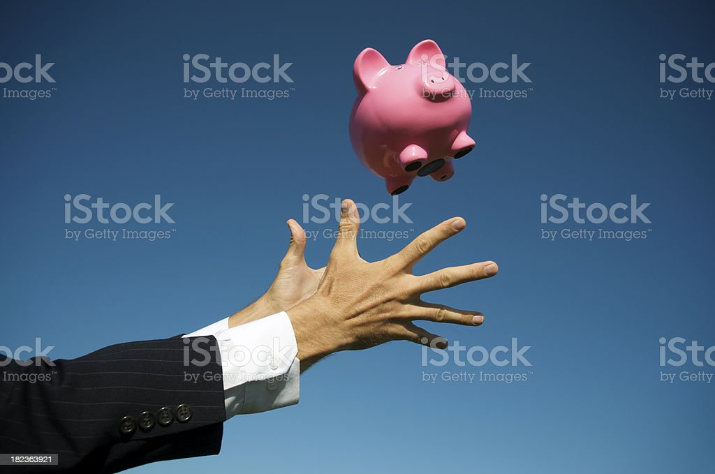 Business Hands Reach Out to Catch Piggy Bank royalty-free stock photo