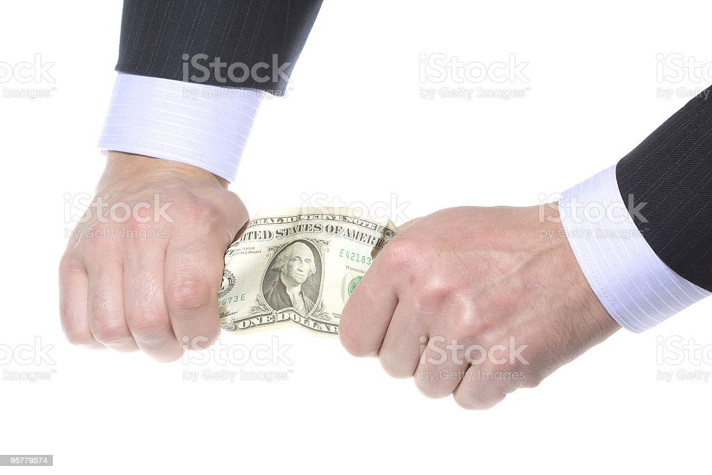 business hands tearing money stock photo