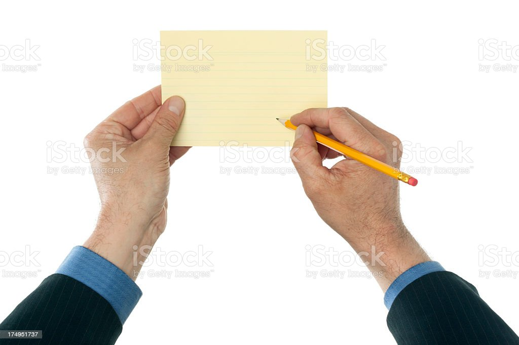Business hands writing on yellow index card royalty-free stock photo