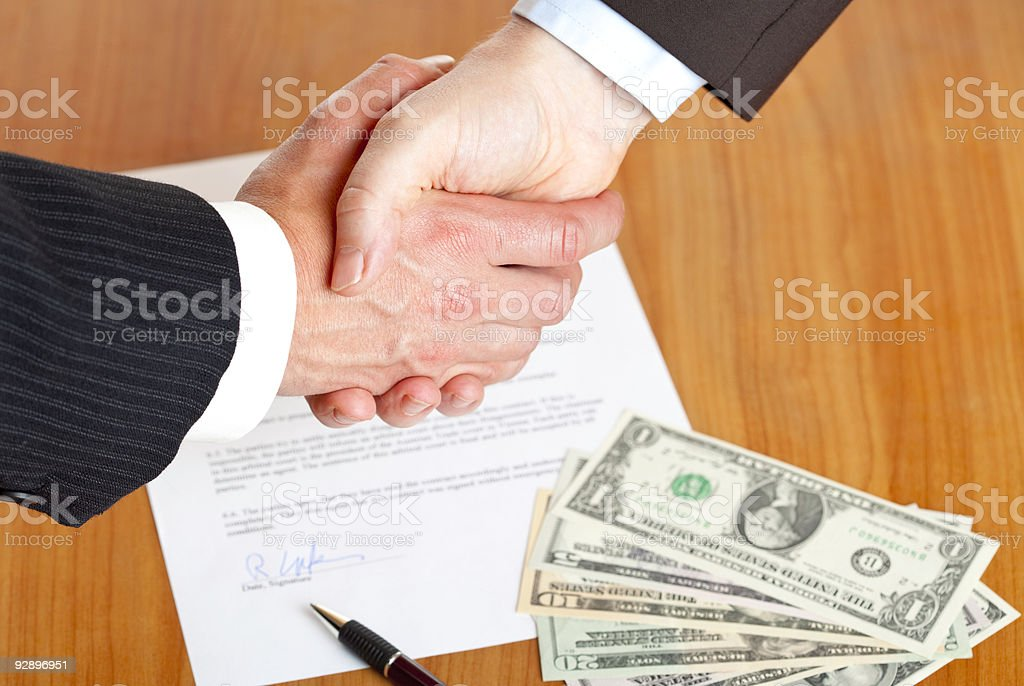 Business handshake after contract signing stock photo