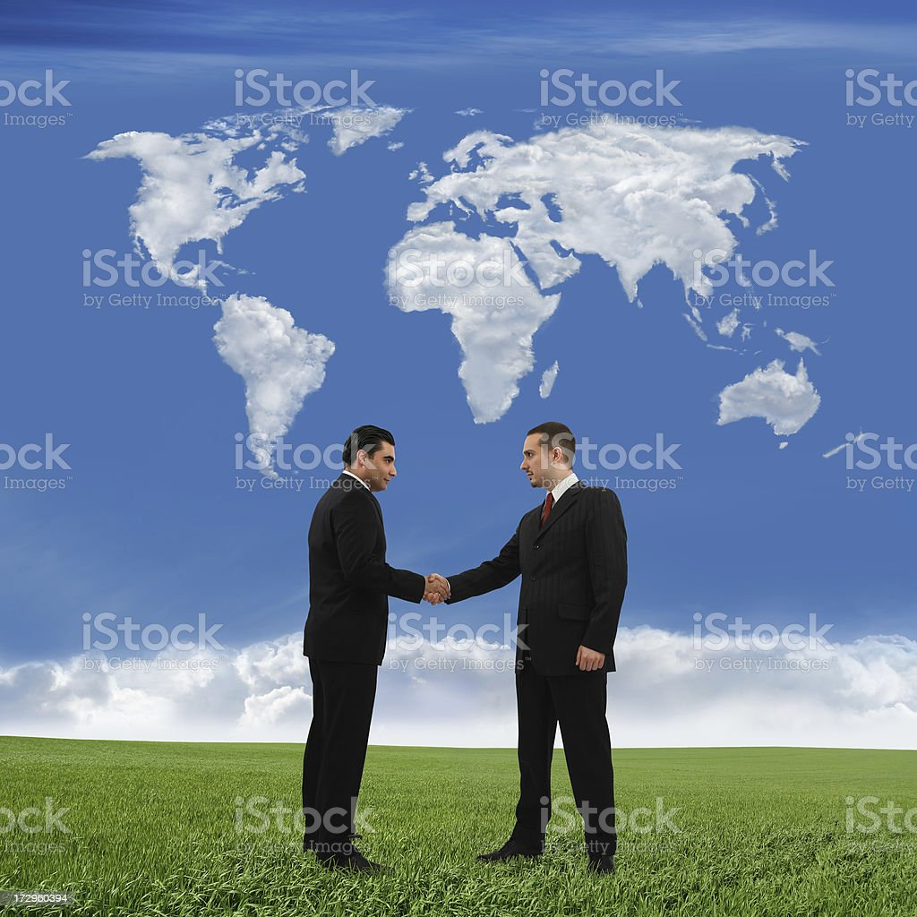 Business Handshake And World Map royalty-free stock photo