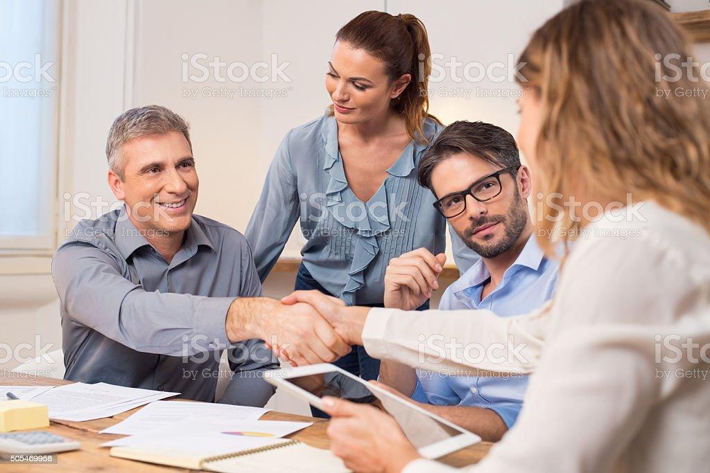 Business handshake during meeting stock photo