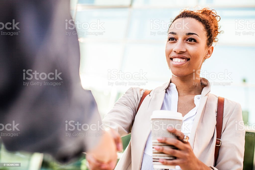 Business handshake in office stock photo