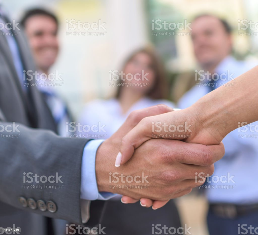 Business handshake of people closing a deal stock photo