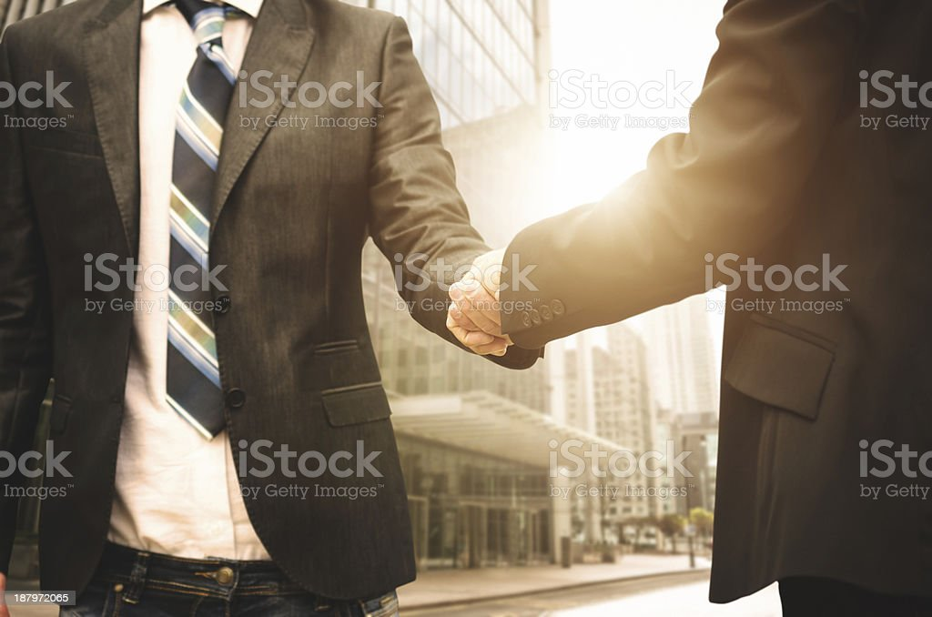 Business handshake on the financial district royalty-free stock photo