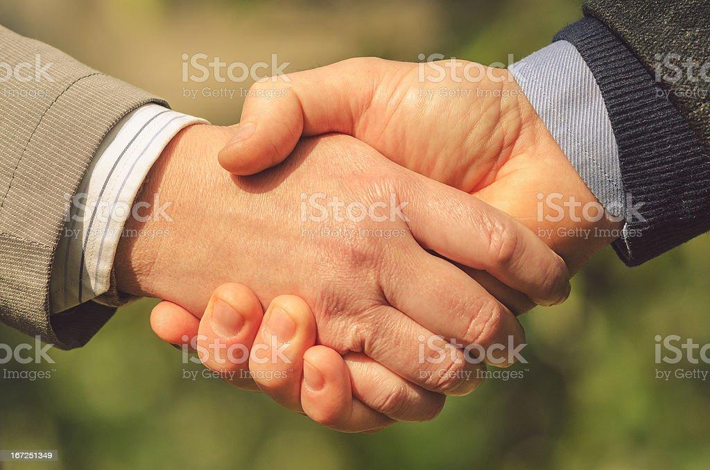 Business handshake outdoors royalty-free stock photo