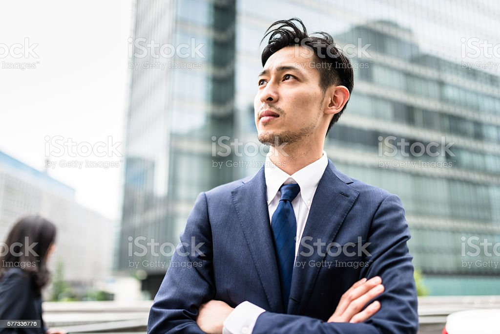 Business japanese standing with arm crossed stock photo