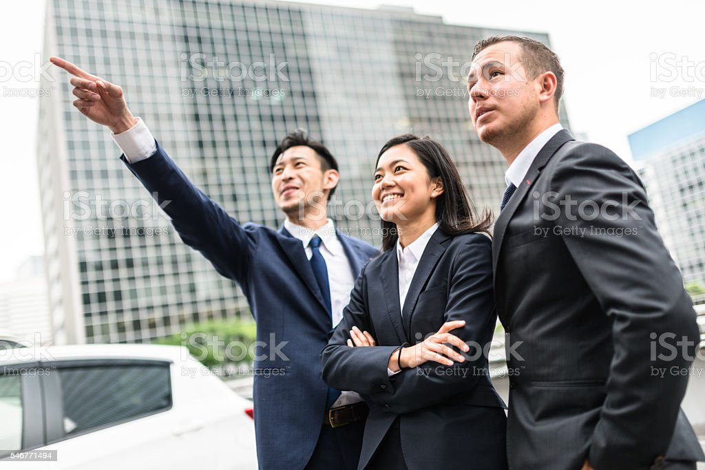 Business japanese team standing togetherness stock photo