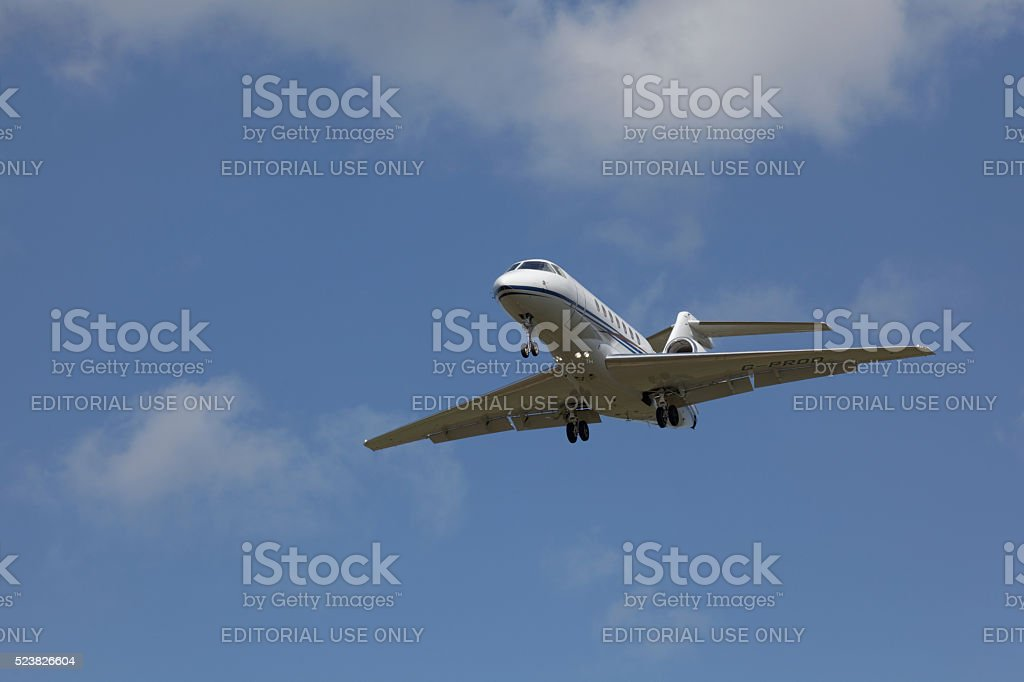 Business jet approaches Edinburgh airport stock photo