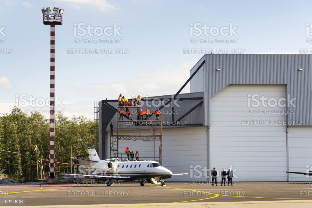 Business jet Cessna Citation Excel 560XL in front of hangar stock photo
