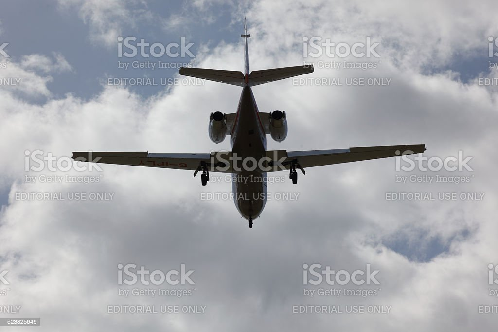 Business jet landing in stormy weather stock photo