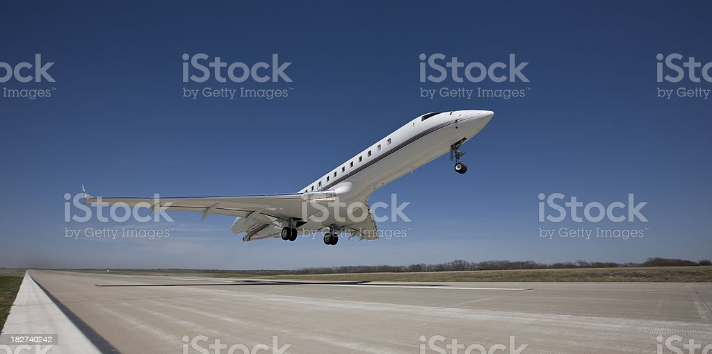 Business Jet Rockets Off The Runway stock photo