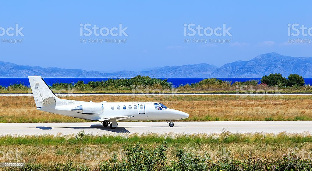 business jet rolls take off. airport strip in Greece Rhodes stock photo