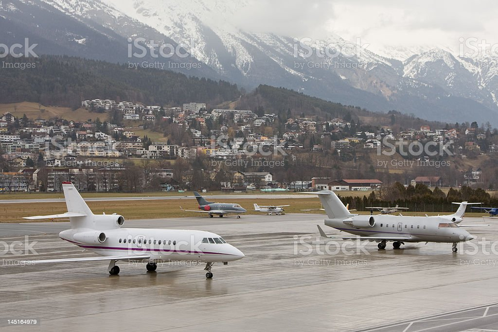 Business jets parked near mountains royalty-free stock photo