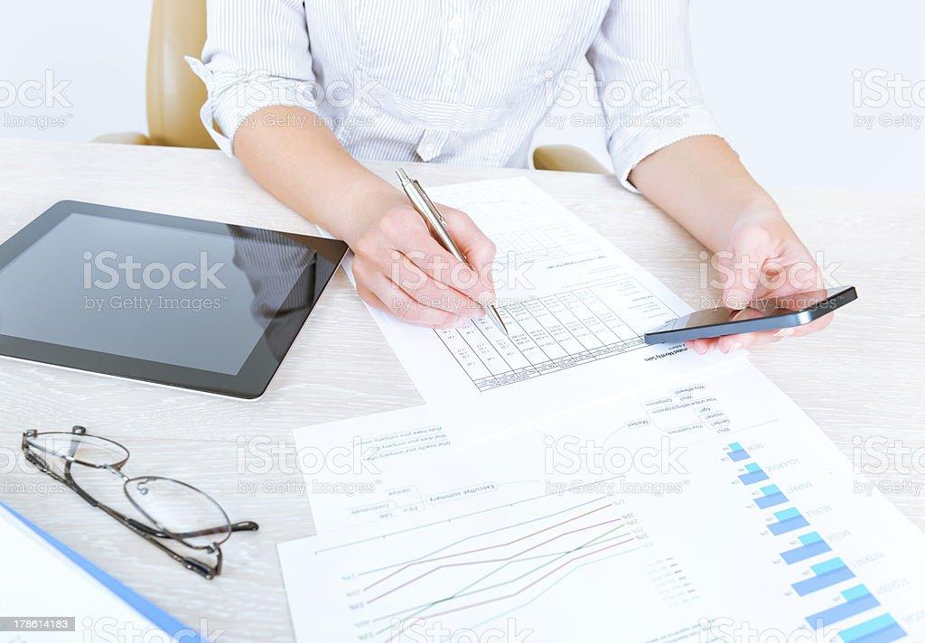 Business lady analyzing statistics stock photo