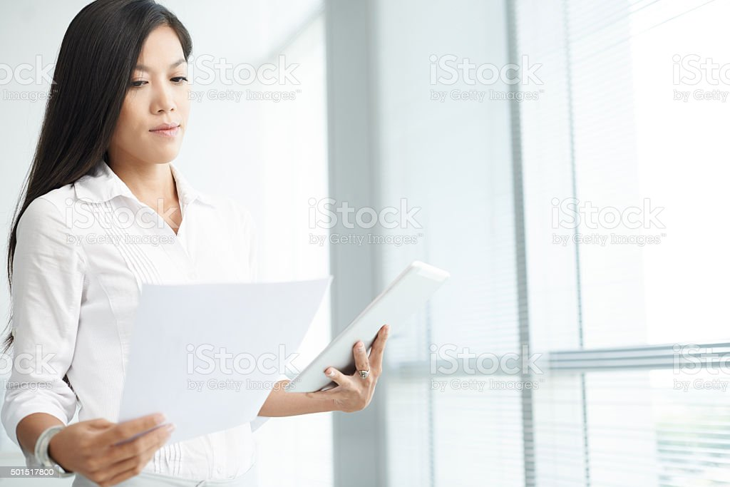 Business lady checking report stock photo
