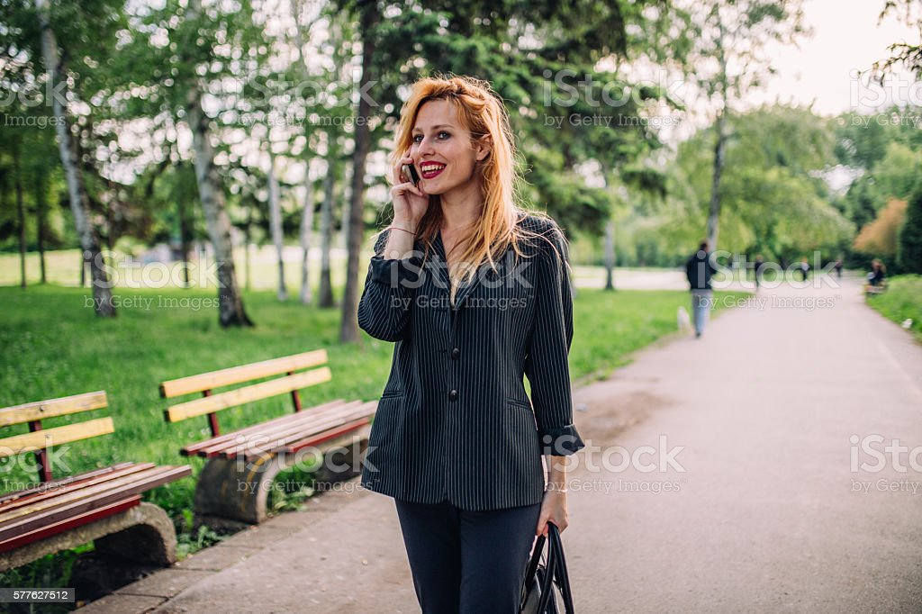 Business lady in park stock photo